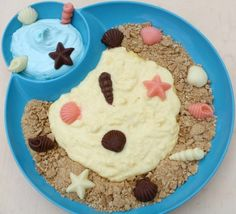 Biscuit sand, pudding and frozen shells, would be good wit blue jelly too.