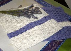 Beautiful cotton dishcloths crocheted in purple and off white.