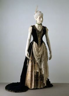 Evening dress Place of origin: New York, USA  Date: 1887-1888  Artist/Maker: Madeleine Laferrière (probably, designer)  E. Wiggins (retailer) Materials and Techniques: Embroidered velvet, silk and satin, lined with cotton and taffeta, boned, machine-made lace, beaded, elastic, seed pearls Museum number: T.278 to C-1972 | V&A