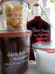 Use a white paint pen to label glass food jars (shown here: Weck Jars, and Bormioli Rocco flask bottle, linked).