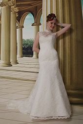 Venus wedding dress/gown- ivory mermaid style wedding dress with lace overlay beading, strapless with high neckline . For the Bride Boutique Ft. Myers, Florida