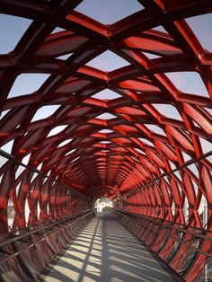A red pedestrian bridge designed by New York-based architect Bernard Tschumi and French firm Hugh Dutton Associés