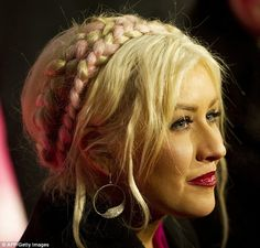 Aguilera pink and blonde braids across her hair