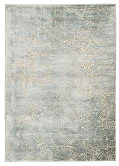 An abstract Mayan-inspired design flashes with light and intricate detailing in this exceptionally-textured New Zealand wool blend rug woven with subtly glowing