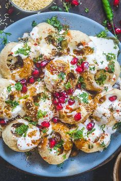 Dahi Puri, which is puri or golgappa topped with various chutneys, masalas and yogurt is easy to put together when all ingredients are pre-prepared. Healthy Indian Snacks, Puri Recipes, Fish Recipes, Chaat Recipe, Pani Puri Recipe, Biryani Recipe, Comida India, Food Porn, Indian Dessert Recipes