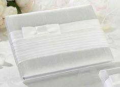 This beautiful pleated white guest book has a soft, tailored look finished off with a bow. Guest book is and holds 55 pages for a total of 990 signatures. Also available in Taupe. Personalized Wedding Favors, Custom Wedding Invitations, Wedding Favours, Wedding Stationery, Trendy Wedding, Our Wedding, Wedding Stuff, Edible Favors, Lillian Rose