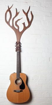 Guitar Hanger by Design Jazz This wall mounted guitar hanger was inspired by nature and folk music. $118