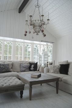 coffee table and ottoman; ornaments hanging from chandelier