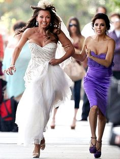 RUNAWAY BRIDE  And they're off! A purple-clad Eva Longoria tries to slow down her Desperate Housewives costar, Vanessa Williams, while shooting scenes for the show Wednesday in L.A.