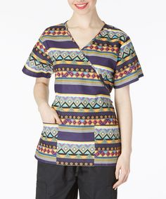 Feel and look your best throughout your shift with this scrub top showcasing a pretty mock wrap cut and a bright print. Size S: long from high point of shoulder to cotton / polyesterMachine washImported Stylish Scrubs, Scrub Tops, Button Down Shirt, Men Casual, Purple, Blouse, Nursing, Mens Tops, Shirts