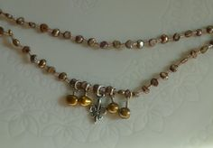 Two strand necklace with a fluer de ley charm by LoveHAIGHTDesigns, $32.00