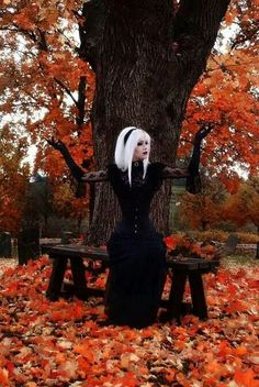 the white hair - the gloves - the fall leaves