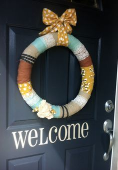 cute DIY fabric wrapped wreath via @Laura Caddell! love the eclectic use of textures & patterns.