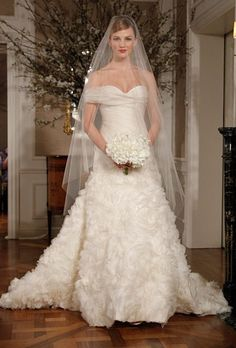 Romona Keveza Couture 2012 - I love the bodice. Again, not in love with the ruffles.