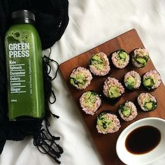 Brown rice sushi mixed with beet juice, avocado, zucchini, parsley with coconut aminos, & a green juice