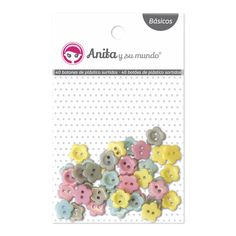 #Botones de plástico en forma de #flor, surtidos en colores pastel. 10 unidades por color. Medida: 1 cm. Ideales para pegar o coser a tus trabajos de #scrapbooking.