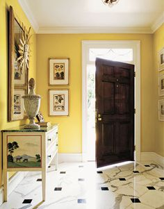 In a Palm Beach entrance hall, designed by Lee Bierly and Christopher Drake, saturated yellow (see next slide) is set off by moldings painted with Benjamin Moore White Dove semigloss enamel.
