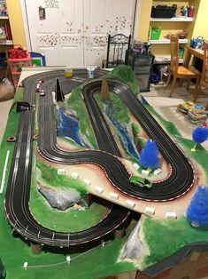Carrera Go slot car layout on table. Trees and pylons are placeholders for landscaping. Slot Car Racing, Slot Car Tracks, Slot Cars, Race Cars, Chevrolet Corvette, Corvette Cabrio, Ferrari 348, Porsche 356, Model Auto