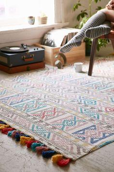 Colourful tassled rug.