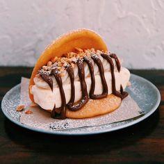 The Baonana split - our handmade golden fried bao with vanilla ice cream, fresh banana slices and salted peanuts drizzled with Nutella. #sorrynotsorry  #bellybao #baonanasplit #baonana #dessertbao #dessert Photo by @feeev