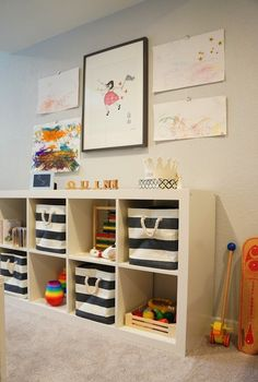 Ikea Expedit Shelving Unit, The Container Store Rugby Stripe Bin, Restoration Hardware Baby & Child Wool Felt C...