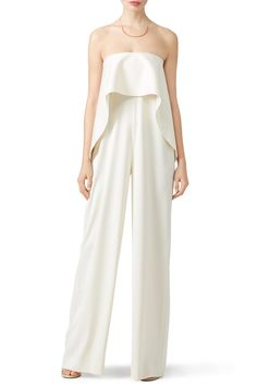 A silky white silhouette makes this Solace London jumpsuit for brides a stand…