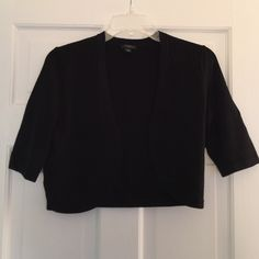 "Ann Taylor SS Shrug NWOT S NWOT black short sleeve shrug, 82% rayon, 16% nylon, 2% spandex.  Super soft medium weight knit.  Center back length 16"".  Thanks for looking. Ann Taylor Sweaters Shrugs & Ponchos"
