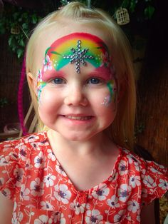 Rainbow design face paint with homemade bling