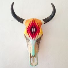 Before my recent trip to Mexico, I had never before seen yarn painting. I was mesmerized by the ancient process where each thread is applied in the same way a brushstroke of paint is applied to a c… Deer Skull Art, Cow Skull Decor, Yarn Painting, Skull Painting, Painted Animal Skulls, Crane, Buffalo Skull, Gado, Antler Art