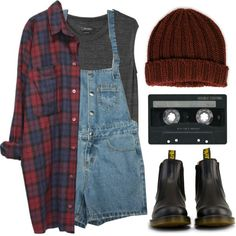 Plaid shirt, grey top, dungarees and beanie.
