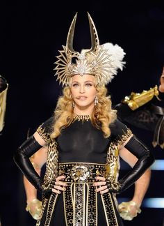 Madonna headlined the Super Bowl XLVI halftime show, and the iconic singer went with a Cleopatra-themed look and appeared on stage in a costume inspired by the famous pharoah. From Madonna's cascading curls and golden crown to her gold eyeshadow and peach lipstick, the Queen of Pop stole the show.