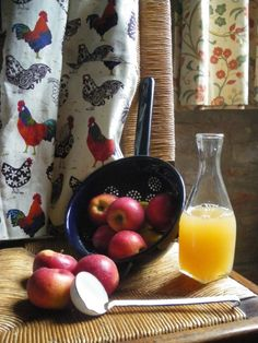 Still life with apples and orange juice