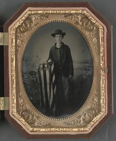 Unidentified young soldier in Union uniform with American flag-draped stand in front of backdrop showing battlefield scene, between 1861 and quarter-plate tintype, hand-colored ; 10 x cm (case). American Civil War, American Flag, American History, Vintage Photography, War Photography, Confederate Flag, Civil War Photos, Antique Photos, Vintage Photos