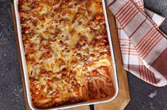 Easy Ravioli Lasagna Bake Recipe - Kraft Recipes - Frozen ravioli, ground beef, extra cheese, sauce, and cream cheese make this a hit!