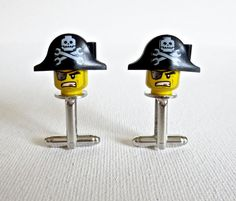 You are looking at a pair of beautiful hand crafted LEGO® pirate cufflinks. Growing up I loved playing with LEGO® Now I continue playing with my son. Material: Plastic Lego® Size: Approx. 1 inch Comes with a free gift box!  Let me know if you have any questions. Thank you! ---------------------------------------------------------------- My Bio: I am a dad before anything else. Love my daughter, my son & my wife. My passion is designing. I use my passion to design to make really cool…