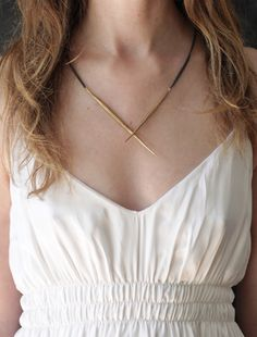 CROSSED BRASS QUILL NECKLACE