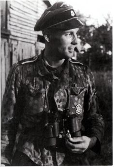 An unidentified Unterscharführer in Normandy. His shoulder-boards indicate he is from 1st SS LSSAH.