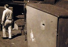 Battle for Iwo Jima, February-March 1945. Battle damage to USS Pensacola (CA 24) caused by Japanese shore batteries on Iwo Jima. Pensacola took six hits from enemy shore batteries as her guns covered operations of the minesweepers close inshore. On 17 February, three of her officers and 14 men were killed. Another five officers and 114 men were injured. U.S. Navy photograph, now in the collections of the National Archives.