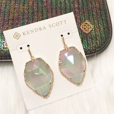 "NEW Kendra Scott Gold Iridescent Drop Earrings NEW Kendra Scott Corley Gold Drop Earrings in Iridescent Slate! Never worn, on earring card. DESCRIPTION: Glistening iridescent slate gems go mod with a geometric edge, creating a star statement no cosmic girl can resist. DETAILS: •14K Gold Plated Over Brass • Size: 1.31""L x 1""W on earwire •Material: iridescent slate cat's eye Kendra Scott Jewelry Earrings"