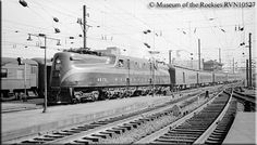 Pennsy GG1 #4870 arrives at Washington, D.C. with a passenger train on June 3, 1940.