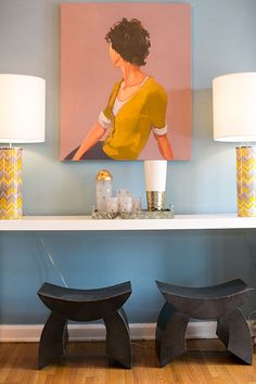 "Sneak Peek: Jessica McKay and Christopher Van Buskirk. ""We love our Christina Renfer Vogel painting in our dining room. It took me a little while to find the perfect spot for it, but once we painted the walls blue, it found a home above the CB2 console. The lamps are from Jonathan Adler."" #sneakpeek"
