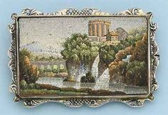 A late 19th century Italian micro mosaic brooch. The rectangular mosaic plaque depicting the Temple of the Sybil at Tivoli, in a silver mount with engraved decoration.
