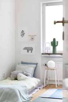 Soft colours, floor bed, sweet kids room