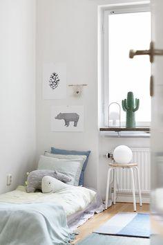 Soft colours, floor bed, sweet kids room