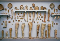 thinkingimages:  Terracotta Body Parts  				Terracotta  Body Parts, Votive offerings from the temple of Asclepius at Corinth. Visitors would pay for a terracotta votive of their affected body part,  and bring it to be stored in the temple. 					 					 						 						less… 					 					Image(s) from www.HolyLandPhotos.org.