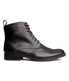 Boots in black faux leather with brogue-style detail, front laces, and rubber soles by H&M