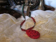 Red Dragon: Carved Coral Carnelian and Jade Necklace. $25.00, via Etsy.