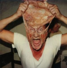 Freddy Krueger stretching his face | 40 Awesome Behind The Scenes Photos From Horror Movies