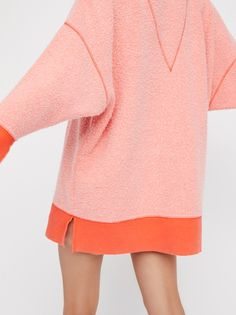 All About It Top | Dreamy oversized V-neck sweatshirt with a fuzzy inside-out bodice and reverse trims.
