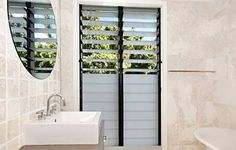 From awnings to bi-folds to louvres, there's a multitude of window options to choose from. To shine a light on your journey through the world of windows, here's a handy A-Z to answer all your window questions. Louvre Windows, Small Basin, Bathroom Images, Bathroom Ideas, Bathroom Color Schemes, Tropical Architecture, Bathroom Windows, Flat Ideas, Tropical Design